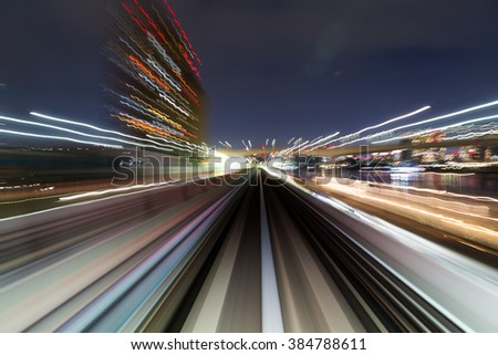 Motion blur of a city and tunnel  #384788611