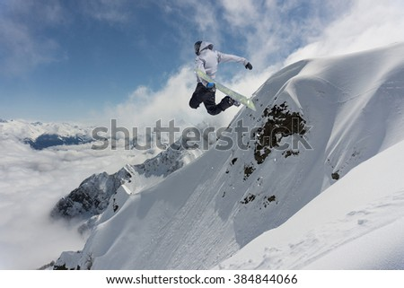 Flying snowboarder on mountains. Extreme sport. #384844066