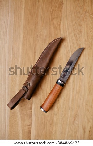 Knife with the wooden handle and a leather sheath #384866623