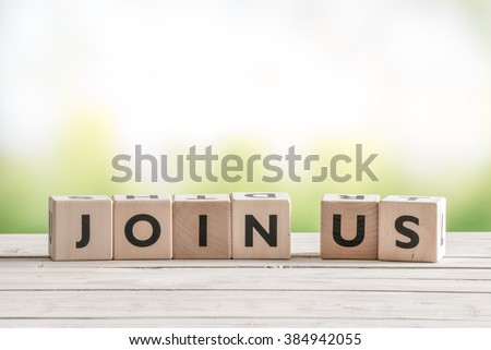 Join us sign on wooden cubes on green background #384942055