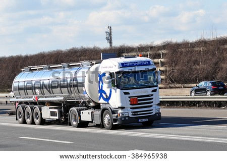 FRANKFURT,GERMANY-FEBR 25: Oil Truck on the highway on February 25,2016 in Frankfurt,Germany. #384965938
