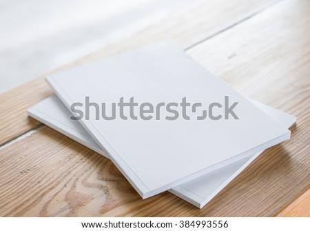 Blank catalog, magazines,book mock up on wood background Royalty-Free Stock Photo #384993556
