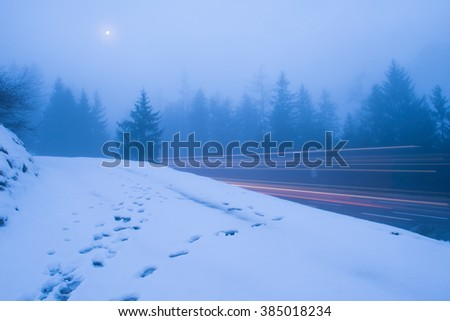 French alps mountain peaks covered with fresh snow. Winter landscape nature scene on night. #385018234