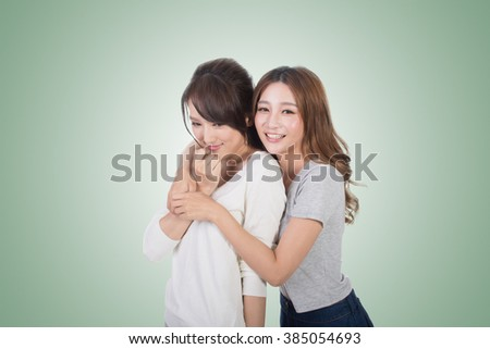 Asian woman with her friend, studio shot portrait. #385054693