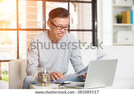 asian matured male paying bills online #385089517