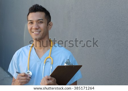 Portrait of young male nurse in scrubs smiling with copy space on the right side of the picture