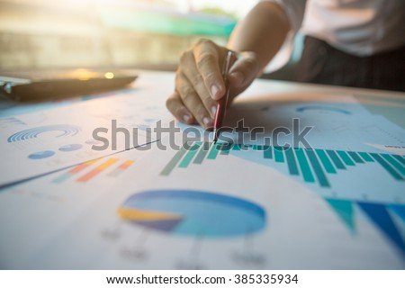 Silhouette of cropped shot of businessman hand working with new modern computer and business strategy as concept,selective focus,flare light Royalty-Free Stock Photo #385335934