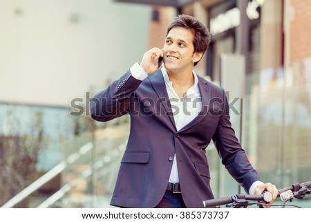 Successful businessman with bicycle #385373737