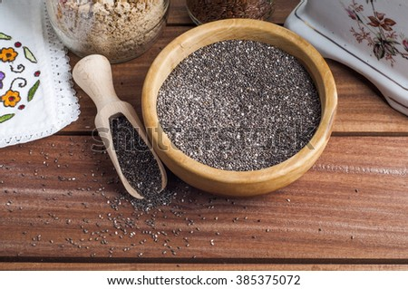 Chia seeds over wooden background  #385375072