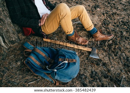 Portrait brutal bearded hipster man in the forest with axe. Sunset #385482439