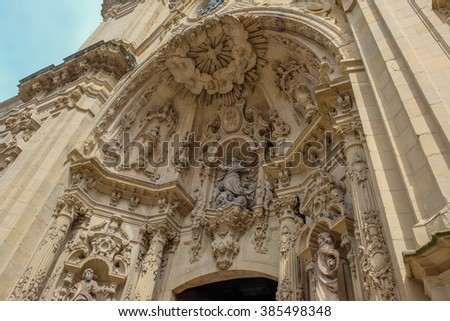 Architectural details, sculptures and ornaments of the  Basilica of Santa Maria del Coro in San Sebastian (Donostia), Basque Country, Spain #385498348
