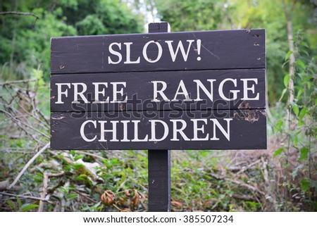 View of a Weathered Free Range Children Sign
