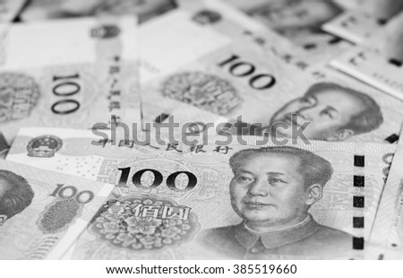 Black and white color background with new series of 100 chinese yuan currency,money.Focus on eyes Mao Tse Tung of banknotes #385519660