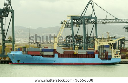 Shipping port with cranes and container ship #38556538