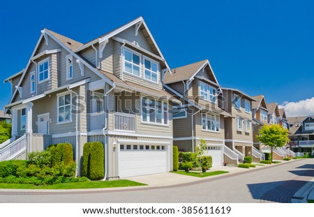 Nice and comfortable neighborhood. Townhouses in the suburbs of Vancouver. Canada. #385611619