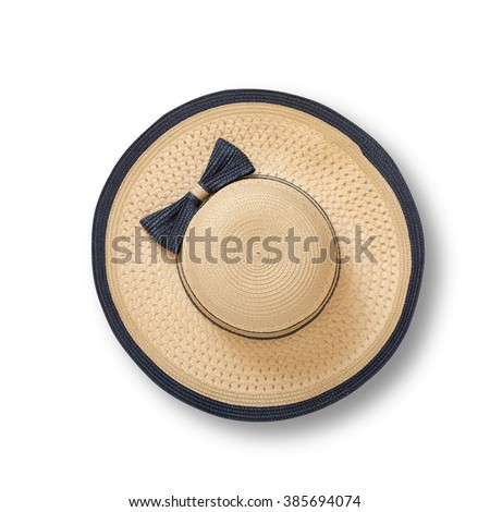 Pretty straw hat with ribbon and bow on white background. Beach hat with shadow top view isolated #385694074