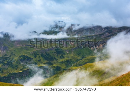 The Grossglockner high Alpine road area in overcast foggy weather #385749190