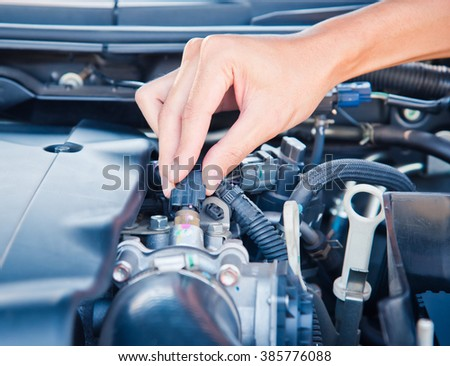 Check the condition of the car engine. #385776088