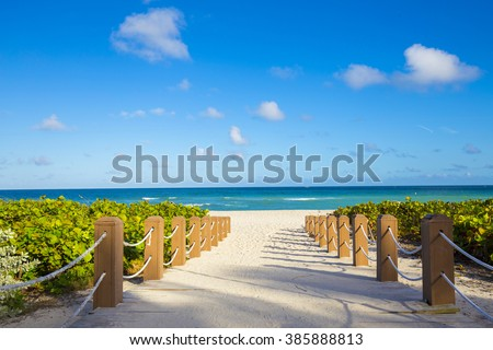Walkway to famous South Beach, Miami Beach, Florida #385888813