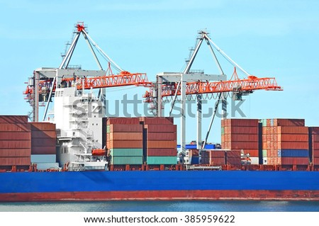 Container stack and ship under crane bridge #385959622