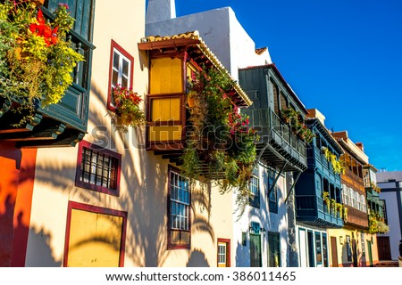 Famous ancient colorful balconies decorated with flowers in Santa Cruz city on La Palma island in Spain Royalty-Free Stock Photo #386011465