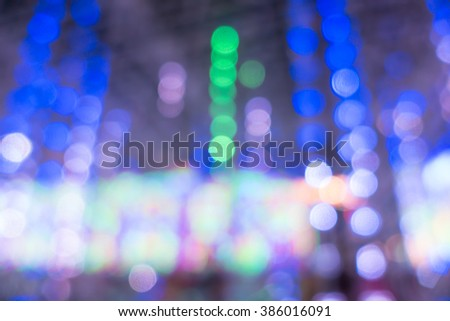 Blurred of lighting carnival background for your design #386016091