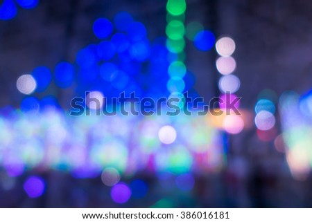 Blurred of lighting carnival background for your design #386016181