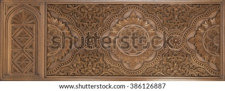 Intricate islamic wood crafted design. Islamic design carved on wooden panel. Royalty-Free Stock Photo #386126887