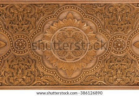 Details of a fine wood carving art. An Islamic art and craft. Royalty-Free Stock Photo #386126890