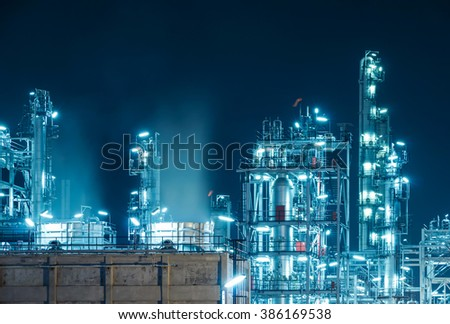 Oil Refinery factory at twilight , petrochemical plant , Petroleum , Chemical Industry  #386169538