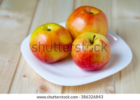 sweet apples in a dish #386326843