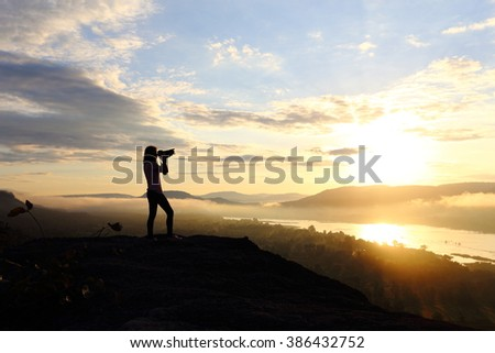 Photography woman with sunrise #386432752