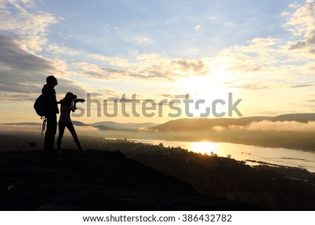 woman and man with sunrise #386432782