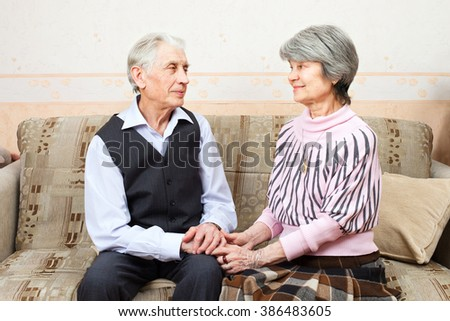 A senior couple are holding handsand and looking at each other #386483605