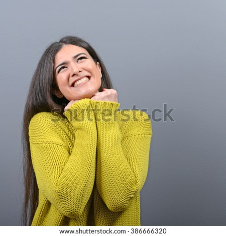 Woman praying about something or begging for mercy against gray background #386666320