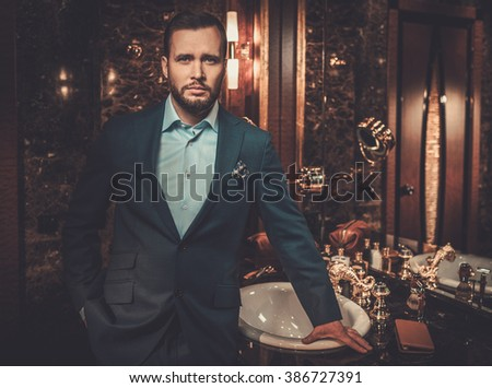 Confident well-dressed man in luxury bathroom interior. #386727391