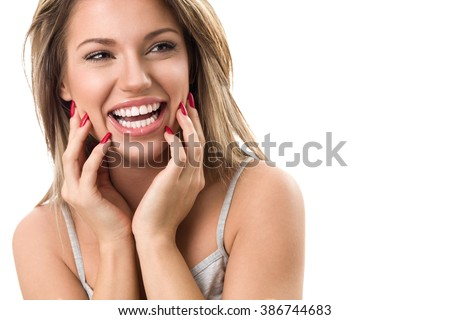 Beautiful young woman laughing and showing her perfect white teeth  #386744683