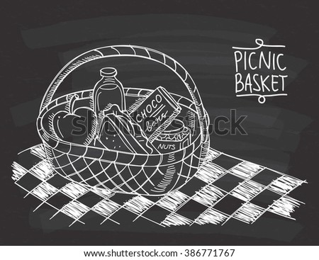 Picnic basket in doodle style on chalkboard background