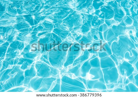 Ripple Water in swimming pool with sun reflection Royalty-Free Stock Photo #386779396