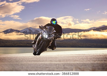 young bike man riding  motorcycle in traveling trip #386812888