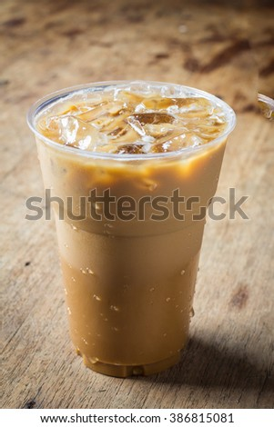 Cold coffee on wooden background #386815081