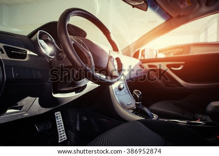 Modern car interior dashboard and steering wheel #386952874