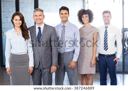 Portrait of confident business team standing in office #387246889