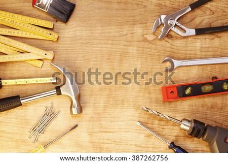 Assorted work tools on wood #387262756