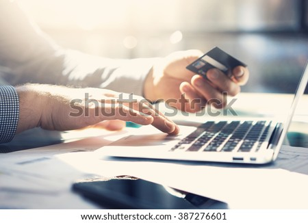 Photo businessman working with generic design notebook. Online payments, banking, hands keyboard. Blurred background, film effect. horizontal mockup Royalty-Free Stock Photo #387276601