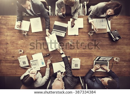 Business People Analyzing Statistics Financial Concept Royalty-Free Stock Photo #387334384