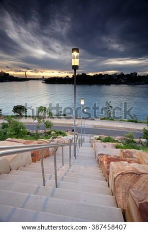 The steps of Barangaroo at dusk, Sydney Australia Royalty-Free Stock Photo #387458407