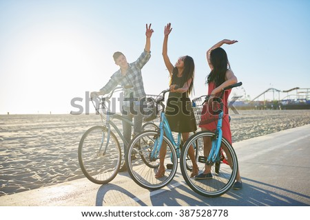 friends on bike doing high five together #387528778