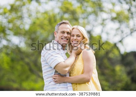 Happy couple about to kiss outside #387539881