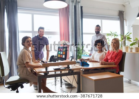 business, startup and people concept - happy creative team in office #387671728